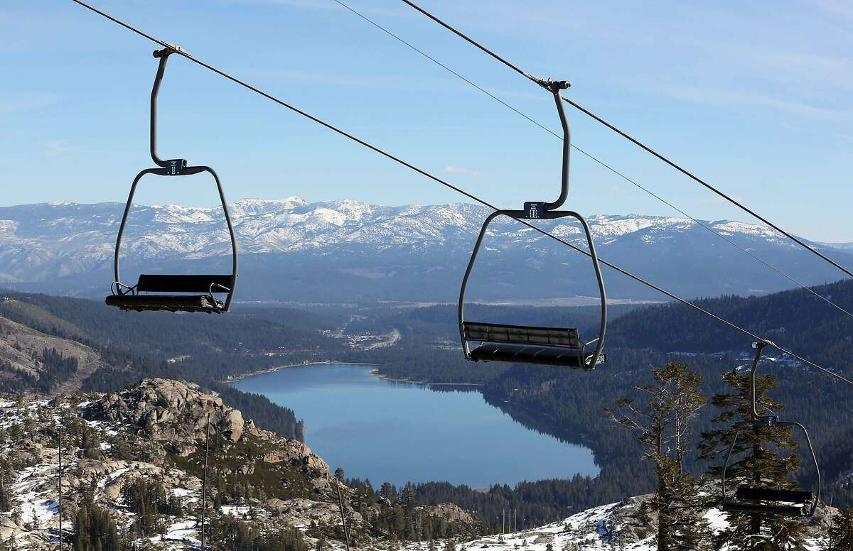 In this Jan. 28, 2015 file photo, chairs on a ski lift overlooking Donner Lake sit idle at Donner Ski Ranch in Norden, Calif.