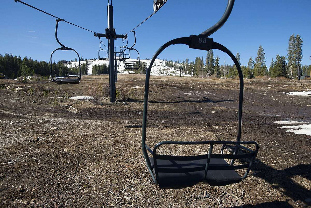 FILE - In this March 18, 2015 file photo, ski lift chairs sit idle at shuttered at Soda Springs Resort in Soda Springs, Calif. The traditional snow season ended April 1 with what appears to be the most dismal Sierra Nevada mountain snowpack on record, cementing 2015's status as the fourth drought year in a row and setting the stage for a difficult summer in California and nearby states. The Lake Tahoe Basin's snowpack Tuesday, March 31, 2015 was only 3 percent of normal for the date and the Truckee River Basin's was measured at 14 percent, far worse than the end-of-season numbers for any of the previous three drought years. (AP Photo/The Sacramento Bee, Randy Pench, File)