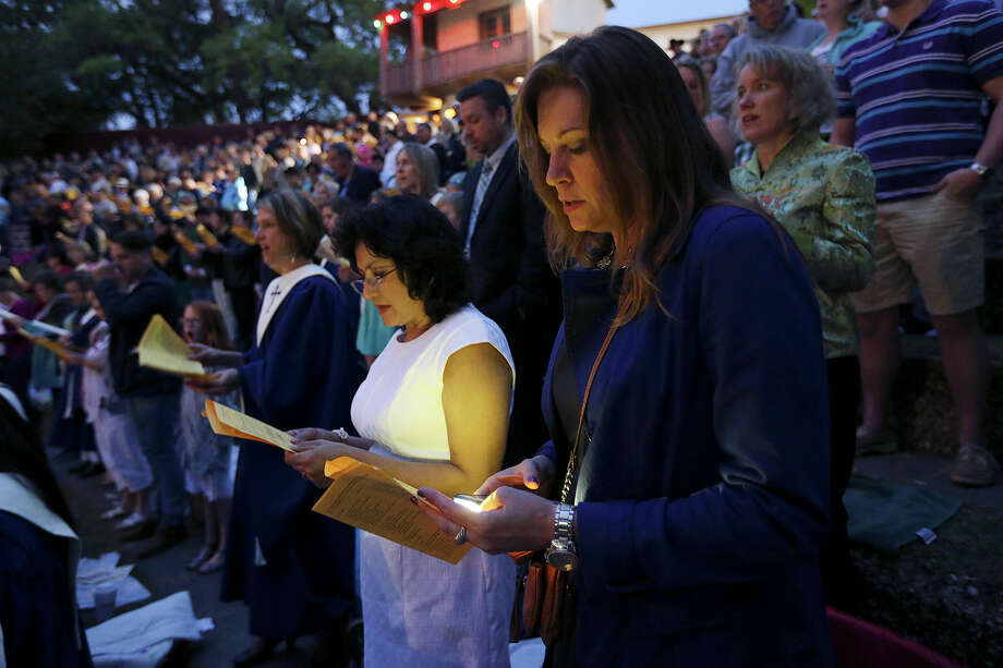 Mary Jane Blair, left, and Maureen Folkerts, of McArthur Park Lutheran Church, particiate in an Easter Sunrise Service at the Arneson River Theater, Sunday, April 5, 2015. Five local Lutheran congregations gathered for the service celebrating Jesus Christ's resurrection. Photo: JERRY LARA, By Jerry Lara, San Antonio Express-News / © 2015 San Antonio Express-News