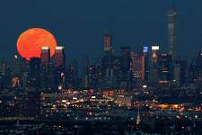 A full moon is seen as it rises over the New York City skyline seen from West Orange, N.J., Saturday, April 4, 2015.
