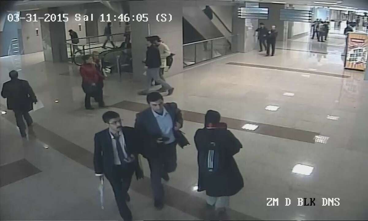 This image obtained from Istanbul courthouse surveillance camera footage on March 31, 2015 shows 2 terrorist gunmen walking towards Turkish prosecutor Mehmet Selim Kiraz's office at Istanbul courthouse in Turkey. Turkish prosecutor Mehmet Selim Kiraz has been taken hostage by terrorist gunmen. Two terrorists captured dead and prosecutor Kiraz, seriously injured and later died at a hospital on March 31, 2015.AP story: PM: Prosecutor wounded in Istanbul hostage standoff has died
