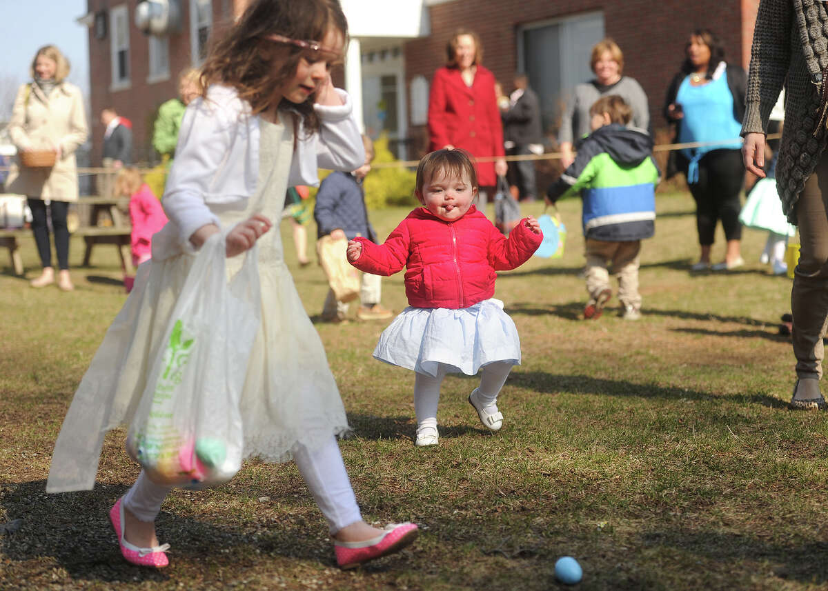 Children of all ages make a mad dash for Easter eggs during the annual egg hunt outside First Congregational Church in Fairfield, Conn. on Sunday, April 5, 2015.