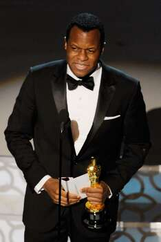 """HOLLYWOOD - MARCH 07:  Screenwriter Geoffrey Fletcher accepts Best Adapted Screenplay award for """"Precious: Based on the Novel 'Push' by Sapphire"""" award onstage during the 82nd Annual Academy Awards held at Kodak Theatre on March 7, 2010 in Hollywood, California.  (Photo by Kevin Winter/Getty Images) *** Local Caption *** Geoffrey Fletcher Photo: Kevin Winter, Getty Images / 2010 Getty Images"""