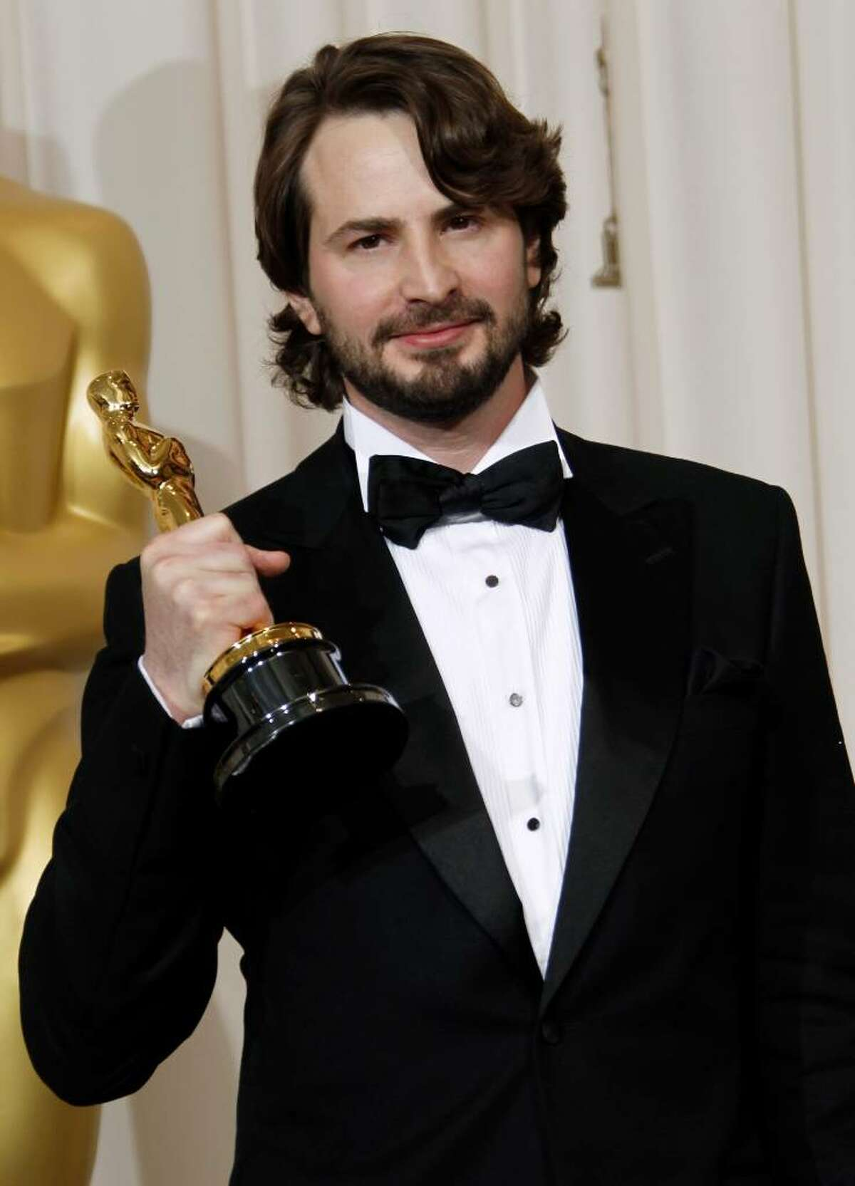 Mark Boal poses backstage with the Oscar for best original screenplay for
