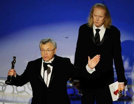 """HOLLYWOOD - MARCH 07:  Ray Beckett (L) and Paul N.J. Ottosson accept Best Sound Editing award for """"The Hurt Locker"""" onstage during the 82nd Annual Academy Awards held at Kodak Theatre on March 7, 2010 in Hollywood, California.  (Photo by Kevin Winter/Getty Images) *** Local Caption *** Ray Beckett;Paul N.J. Ottosson Photo: Kevin Winter, Getty Images / 2010 Getty Images"""