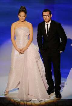HOLLYWOOD - MARCH 07:  Actors Jennifer Lopez and Sam Worthington present onstage during the 82nd Annual Academy Awards held at Kodak Theatre on March 7, 2010 in Hollywood, California.  (Photo by Kevin Winter/Getty Images) *** Local Caption *** Jennifer Lopez;Sam Worthington Photo: Kevin Winter, Getty Images / 2010 Getty Images