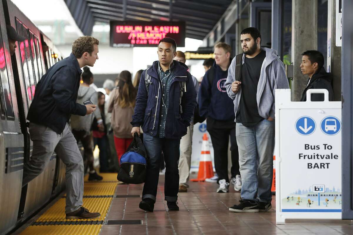 A BART passenger disembarks at the Coliseum Station in Oakland on Sunday, April 5, 2015. A section of track between the Coliseum and Fruitvale stations will be closed on Sundays while crews replace aging tracks and ties. BART and AC Transit are offering shuttles between the two stations during the closures.
