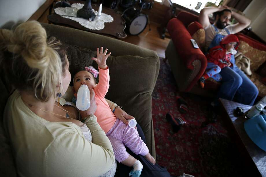Sam Torreano feeds private donor breast milk to her 8-month-old baby Seneca Jahi in Oakland, Calif., on Sunday, April 5, 2015. Photo: Scott Strazzante, The Chronicle