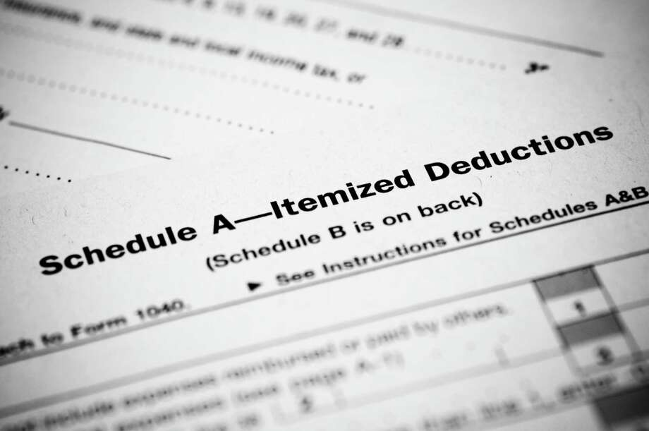 The Internal Revenue Service allows you to take the cost of certain items, known as itemized deductions, off your tax bill if you qualify. You should itemize deductions if they add up to more than your standard deduction, the IRS advises. For filing your taxes, you itemize deductions on IRS Schedule A. Photo: Getty Images