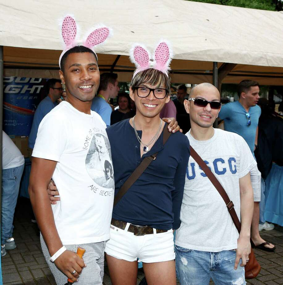Guests pose for a photo at the Bunnies on the Bayou 36 in Fish Plaza Sunday, April 5, 2015, in Houston. Photo: Jon Shapley, Houston Chronicle / © 2015 Houston Chronicle