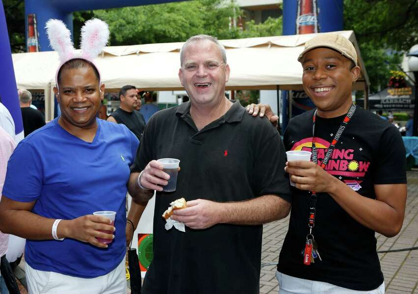 Guests pose for a photo at the Bunnies on the Bayou 36 in Fish Plaza Sunday, April 5, 2015, in Houston.