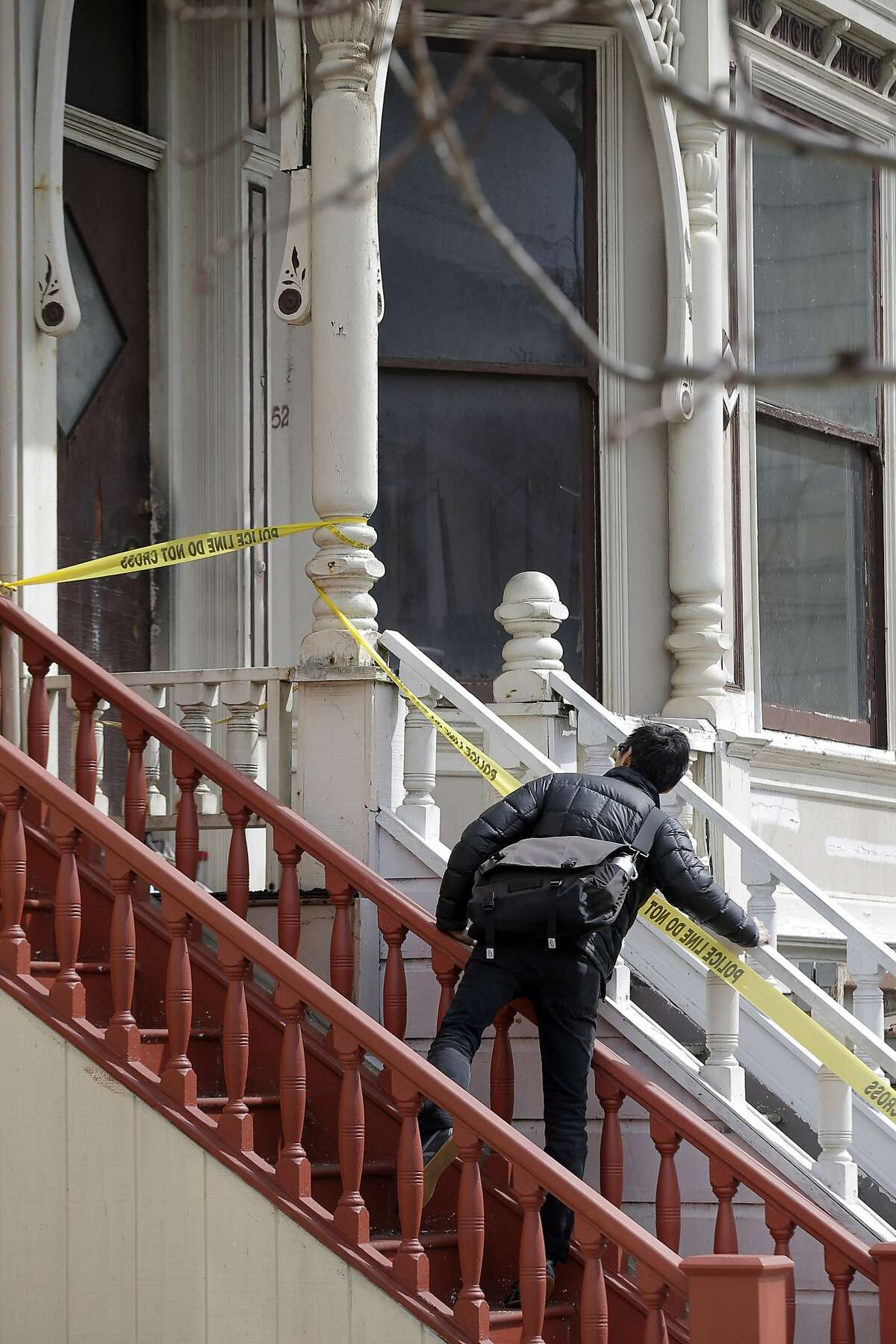 San Francisco Supervisor Eric Mar tries to look into a home on 4th Avenue on Sunday, April 5, 2015, in San Francisco , Calif. where a mummified body had been discovered the day before. Mar was looking for comments from neighbors on how the city could prevent the spread of vermin and spiders as the home is emptied and to provide services for mental health or senior care to stop such a thing from happening to other elders.