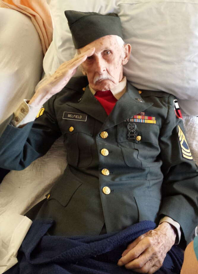 Times Union Archive World War II Army veteran Justus ?Jay? Belfield, 98, renders his final salute from a nursing home bed hours before he died.
