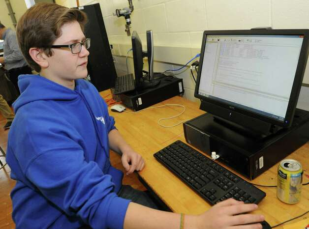 Sophomore Mitchell Gerhardt, 15, works on programing for the cortex of the robot during a Blue Streaks Robotics Club meeting at Saratoga Springs High School on Tuesday, March 31, 2015 in Saratoga Springs, N.Y. The Blue Streaks Robotics Club won the NYS Championship in February at Onondaga Community College. They're going to nationals next month to take on 450 teams from across the world. (Lori Van Buren / Times Union) Photo: Lori Van Buren / 00031241A