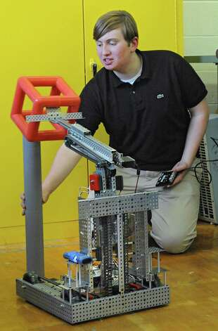 Junior Paul Harrington, 17, club president, demonstrates how the robot works during a Blue Streaks Robotics Club meeting at Saratoga Springs High School on Tuesday, March 31, 2015 in Saratoga Springs, N.Y. The Blue Streaks Robotics Club won the NYS Championship in February at Onondaga Community College. They're going to nationals next month to take on 450 teams from across the world. (Lori Van Buren / Times Union) Photo: Lori Van Buren / 00031241A
