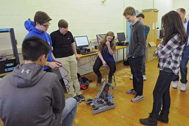 Members of the Blue Streaks Robotics Club work on their robot during a meeting at Saratoga Springs High School on Tuesday, March 31, 2015 in Saratoga Springs, N.Y. The Blue Streaks Robotics Club won the NYS Championship in February at Onondaga Community College. They're going to nationals next month to take on 450 teams from across the world. (Lori Van Buren / Times Union) Photo: Lori Van Buren / 00031241A