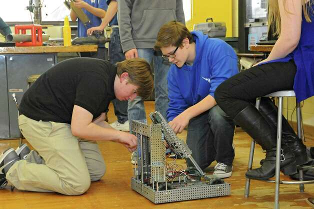 Eleventh grade club president Paul Harrington, 17, and sophomore Mitchell Gerhardt, 15, work on the robot during a Blue Streaks Robotics Club meeting at Saratoga Springs High School on Tuesday, March 31, 2015 in Saratoga Springs, N.Y. The Blue Streaks Robotics Club won the NYS Championship in February at Onondaga Community College. They're going to nationals next month to take on 450 teams from across the world. (Lori Van Buren / Times Union) Photo: Lori Van Buren / 00031241A