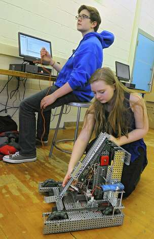 Sophomore Mitchell Gerhardt, 15, works on programing for the cortex of the robot as freshman Amanda Davis, 14, connects the vexnet key to the robot during a Blue Streaks Robotics Club meeting at Saratoga Springs High School on Tuesday, March 31, 2015 in Saratoga Springs, N.Y. The Blue Streaks Robotics Club won the NYS Championship in February at Onondaga Community College. They're going to nationals next month to take on 450 teams from across the world. (Lori Van Buren / Times Union) Photo: Lori Van Buren / 00031241A