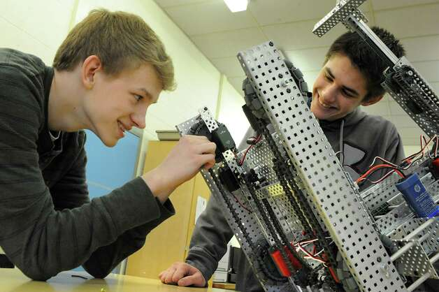 Juniors Lucas Beitzel, 16, left, and Kevin Postlethwait, 17, work on the robot during a Blue Streaks Robotics Club meeting at Saratoga Springs High School on Tuesday, March 31, 2015 in Saratoga Springs, N.Y. The Blue Streaks Robotics Club won the NYS Championship in February at Onondaga Community College. They're going to nationals next month to take on 450 teams from across the world. (Lori Van Buren / Times Union) Photo: Lori Van Buren / 00031241A