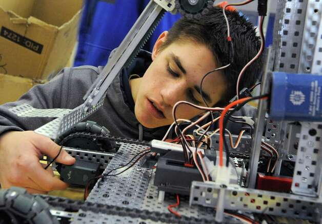 Junior Kevin Postlethwait, 17, works on the robot during a Blue Streaks Robotics Club meeting at Saratoga Springs High School on Tuesday, March 31, 2015 in Saratoga Springs, N.Y. The Blue Streaks Robotics Club won the NYS Championship in February at Onondaga Community College. They're going to nationals next month to take on 450 teams from across the world. (Lori Van Buren / Times Union) Photo: Lori Van Buren / 00031241A