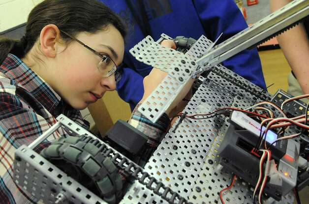 Freshman Julius Cucinella, 14, works on the robot during a Blue Streaks Robotics Club meeting at Saratoga Springs High School on Tuesday, March 31, 2015 in Saratoga Springs, N.Y. The Blue Streaks Robotics Club won the NYS Championship in February at Onondaga Community College. They're going to nationals next month to take on 450 teams from across the world. (Lori Van Buren / Times Union) Photo: Lori Van Buren / 00031241A