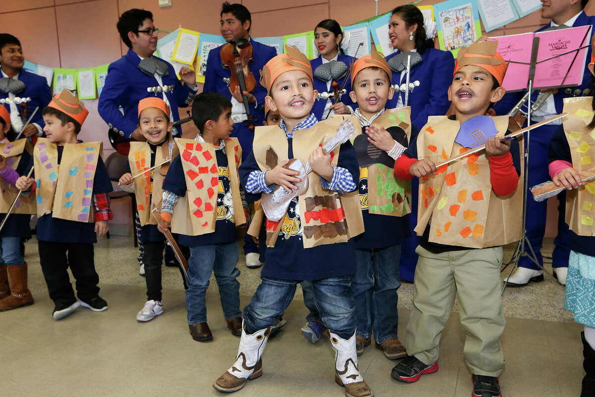 """Early childhood education is highly correlated to success later in life for the students. Fewer go to jail and prison. David Arita (front), 4 and other from Carvalal Early Childhood Education Center sing as they and Lanier High School presented """"Heart and Soul of the Westside"""" at the Good Samaritan Community Center, in March."""