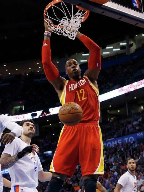 """Dwight Howard gets the kind of shot Josh Smith said """"we need to get him going"""" in Sunday's win. Photo: Sue Ogrocki, STF / AP"""