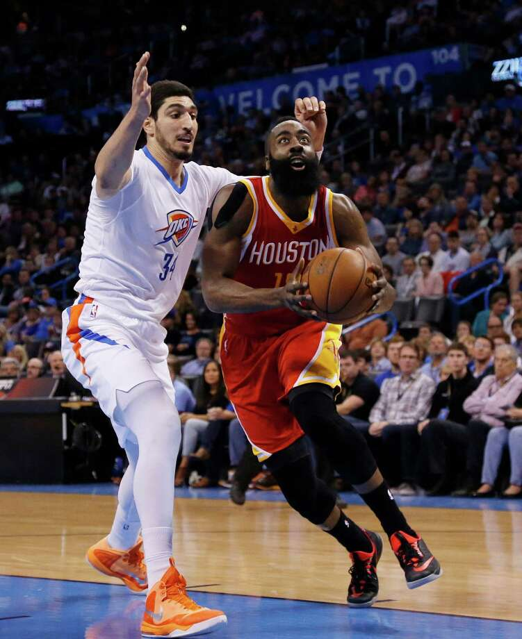 James Harden gets past the Thunder's Enes Kanter during a 41-point game that included 10 straight points in one fourth-quarter stretch. Photo: Sue Ogrocki, STF / AP