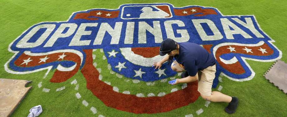 Working near home plate Sunday, grounds crew member Fitima Alvizo helps prepare Minute Maid Park for tonight's opener against the Indians. Story on page C1 Photo: Melissa Phillip, Staff / © 2015  Houston Chronicle