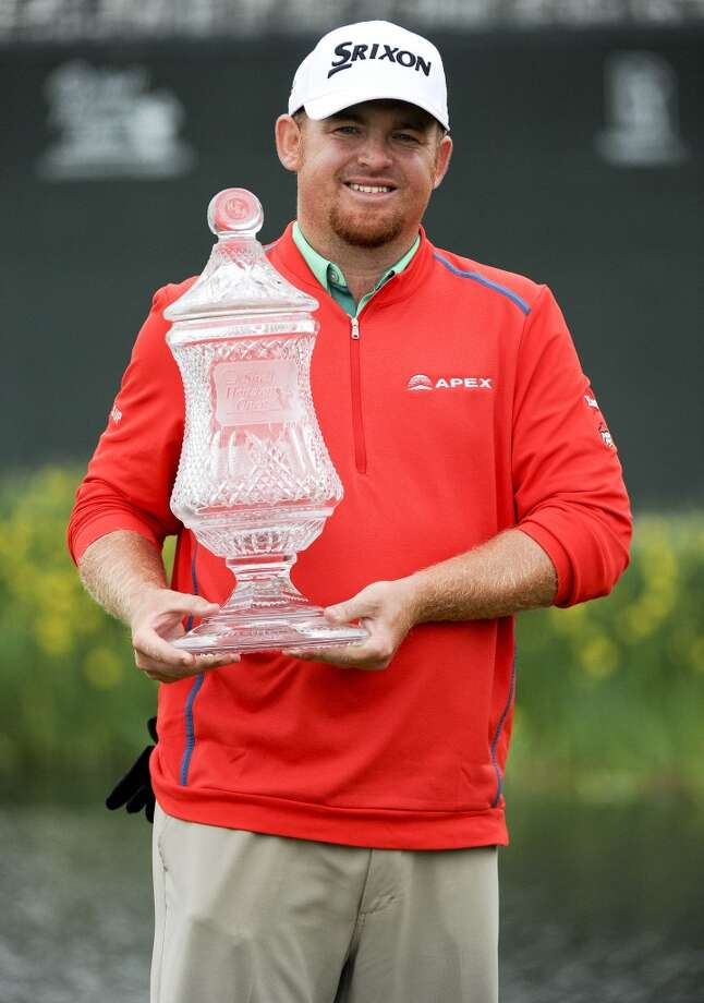 J.B. Holmes poses with the champion's trophy after winning the Shell Houston Open on the second playoff hole against Johnson Wagner, Sunday, April 5, 2015, at the Golf Club of Houston in Humble, TX. (Photo: Eric Christian Smith/For the Chronicle) Photo: For The Chronicle