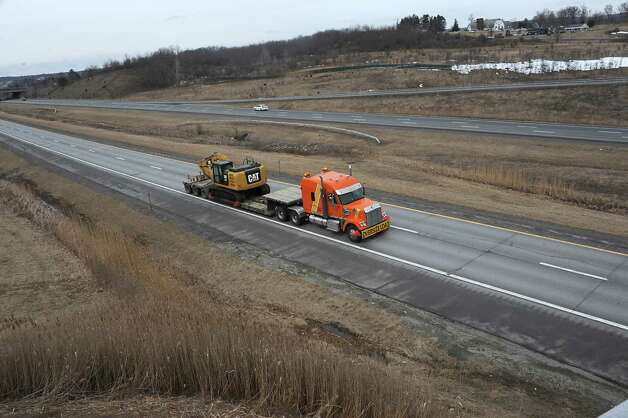 A construction project to pave this stretch of I-88 eastbound from just beyond the toll booths in Schenectady County out to the Schoharie County line will be done this summer Friday, April 3, 2015 in Duanesburg, N.Y.  (Lori Van Buren / Times Union) Photo: Lori Van Buren / 00031300A