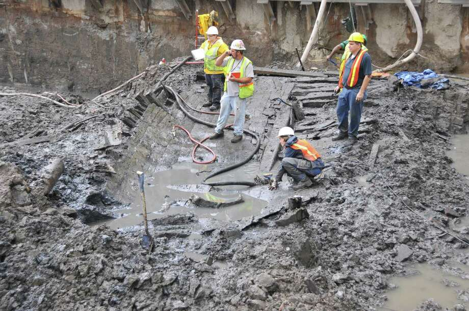 For more than 200 years, a wooden sloop sat in the mud of the Hudson River shoreline in lower Manhattan. It was discovered below the remains of the World Trade Center. (Photos courtesy of Lower Manhattan Development Corp.)