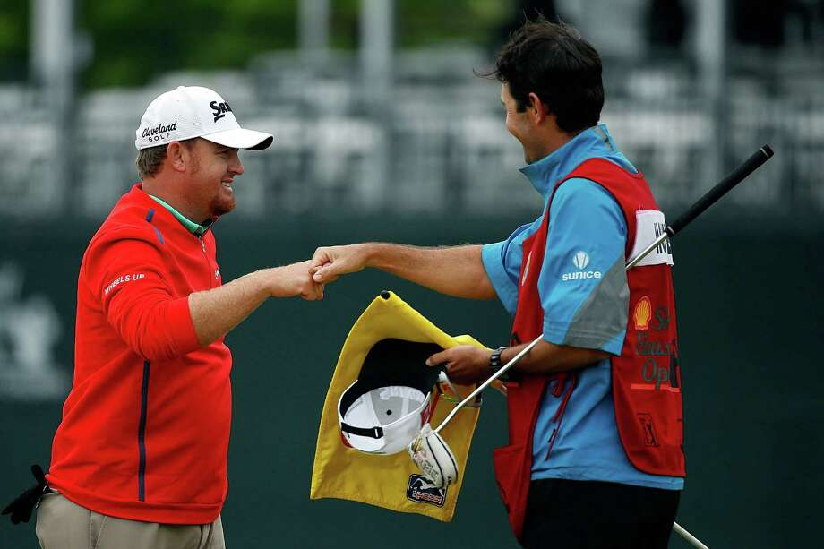 HUMBLE, TX - APRIL 05: J.B. Holmes congratulates his caddie after winning the Shell Houston Open at the Golf Club of Houston on the second hole of a playoff on April 5, 2015 in Humble, Texas. (Photo by Scott Halleran/Getty Images) ORG XMIT: 527751895 Photo: Scott Halleran / 2015 Getty Images