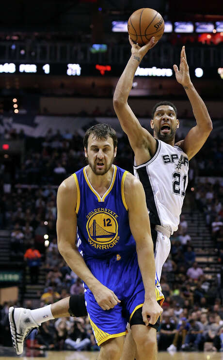 San Antonio Spurs' Tim Duncan reacts after being fouled by Golden State Warriors' Andrew Bogut during first half action Sunday April 5, 2015 at the AT&T Center. Photo: Edward A. Ornelas, Staff / San Antonio Express-News / © 2015 San Antonio Express-News
