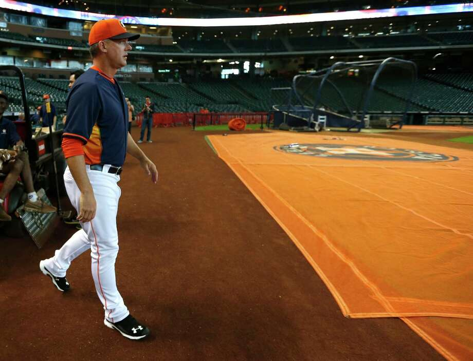 Astros manager A.J. Hinch gets a look at his new workplace before Friday's exhibition game against the Royals. Photo: Karen Warren, Staff / © 2015 Houston Chronicle