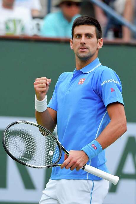 Novak Djokovic, of Serbia, celebrates  winning a game while playing Roger Federer, of Switzerland, during their final match at the BNP Paribas Open tennis tournament, Sunday, March 22, 2015, in Indian Wells, Calif. (AP Photo/Mark J. Terrill) Photo: Mark J. Terrill, STF / AP