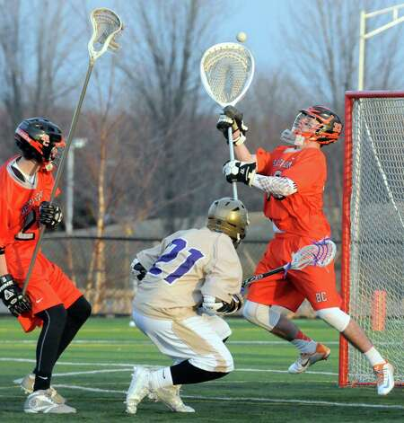 Bethlehem senior goalie Dan Comber, right, makes a save during their high school lacrosse game against CBA  at the Christian Plumeri Sports Complex on Tuesday March 31, 2015 in Albany, N.Y. (Michael P. Farrell/Times Union) Photo: Michael P. Farrell / 00031221A