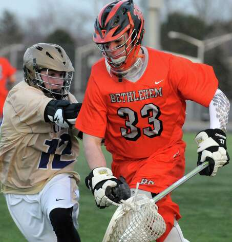 Bethlehem senior goalie Dan Comber, right, during their high school lacrosse game against CBA  at the Christian Plumeri Sports Complex on Tuesday March 31, 2015 in Albany, N.Y. (Michael P. Farrell/Times Union) Photo: Michael P. Farrell / 00031221A