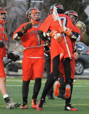Bethlehem celebrates after scoring during their high school lacrosse game against CBA at the Christian Plumeri Sports Complex on Tuesday March 31, 2015 in Albany, N.Y. (Michael P. Farrell/Times Union) Photo: Michael P. Farrell / 00031221A