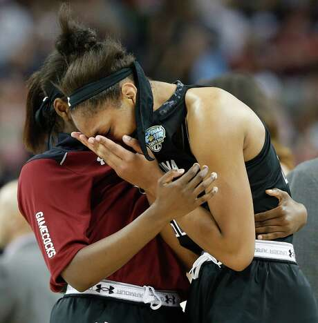 South Carolina's A'ja Wilson deals with the agony of a one-point loss in the national semifinals. Photo: Brynn Anderson, STF / AP