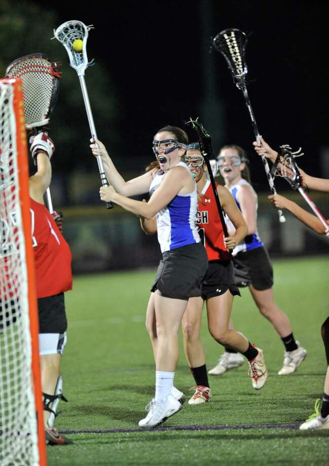 Shaker's Kailyn Hart (5) scores against Guilderland during their Section II Class A girls' lacrosse final at the University at Albany campus in Albany, N.Y., Wednesday, May 21, 2014. (Hans Pennink / Special to the Times Union) ORG XMIT: HP102 Photo: Hans Pennink / Hans Pennink