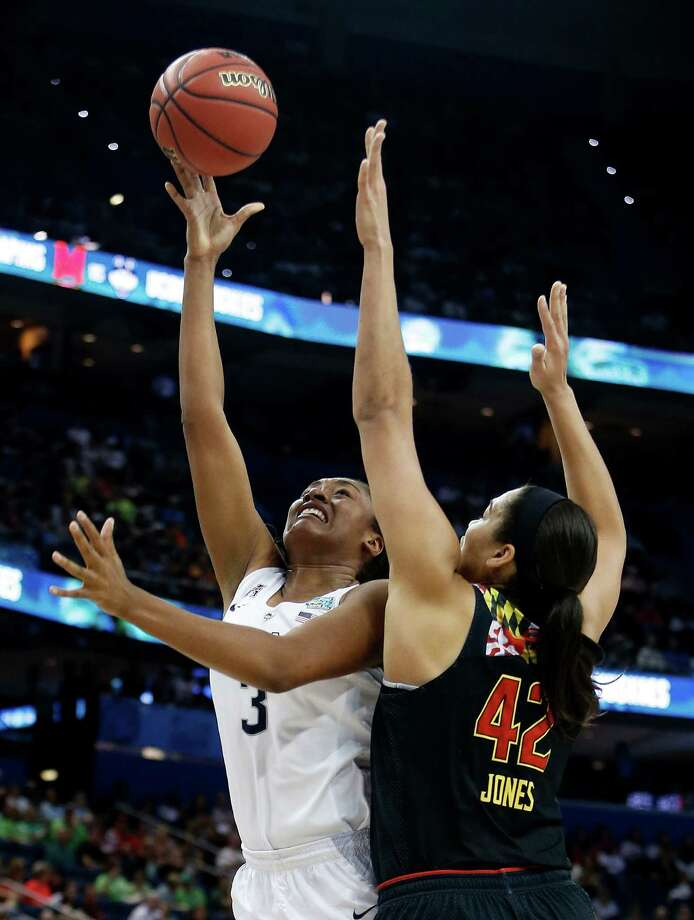 TAMPA, FL - APRIL 05:  Morgan Tuck #3 of the Connecticut Huskies shoots against Brionna Jones #42 of the Maryland Terrapins in the second half during the NCAA Women's Final Four Semifinal at Amalie Arena on April 5, 2015 in Tampa, Florida.  (Photo by Brian Blanco/Getty Images) ORG XMIT: 527066965 Photo: Brian Blanco / 2015 Getty Images