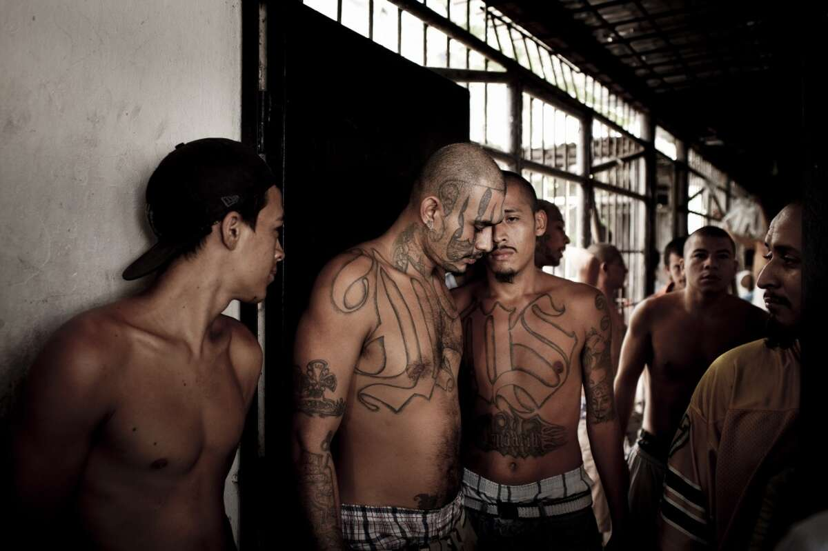 7. Members of the MS13 are known to display the gang's colors - blue and white. Those are the same colors as the El Salvador flag. Members of the Mara Salvatrucha gang at the Ciudad Barrios prison in Ciudad Barrios, El Salvador in 2012.