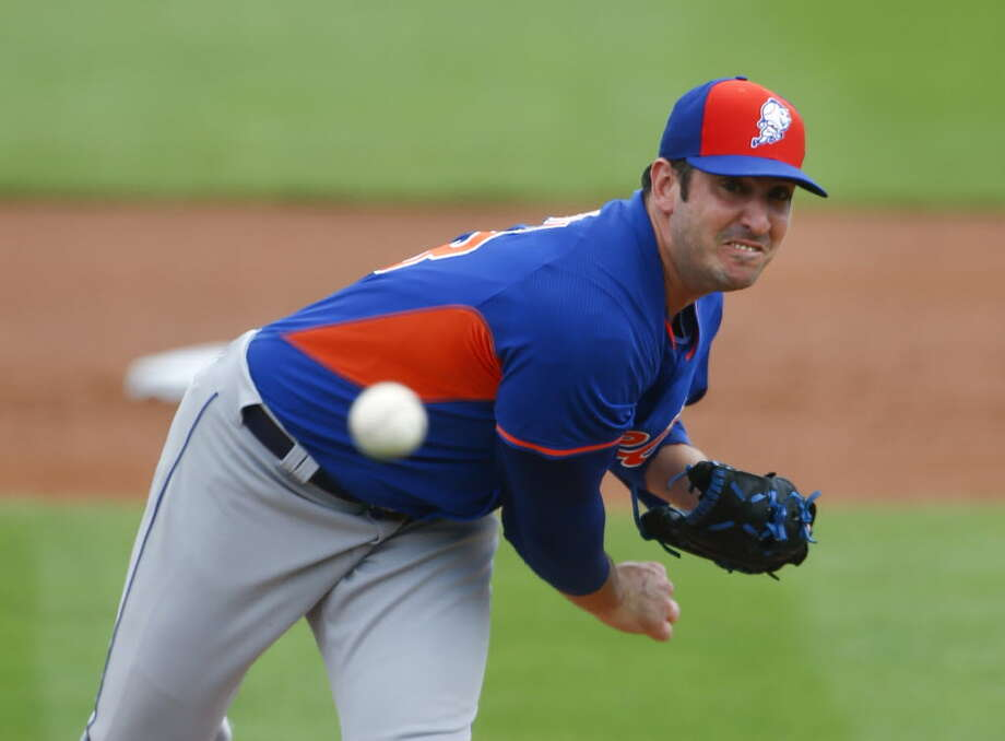 In this March 11, 2015, file photo, New York Mets starting pitcher Matt Harvey throws during a pring training baseball game against the Miami Marlins in Jupiter, Fla. Harvey is scheduled to pitch for the Mets against the St. Louis Cardinals on Thursday, April 2, in the final game of spring training for the two teams. (AP Photo/John Bazemore, File)