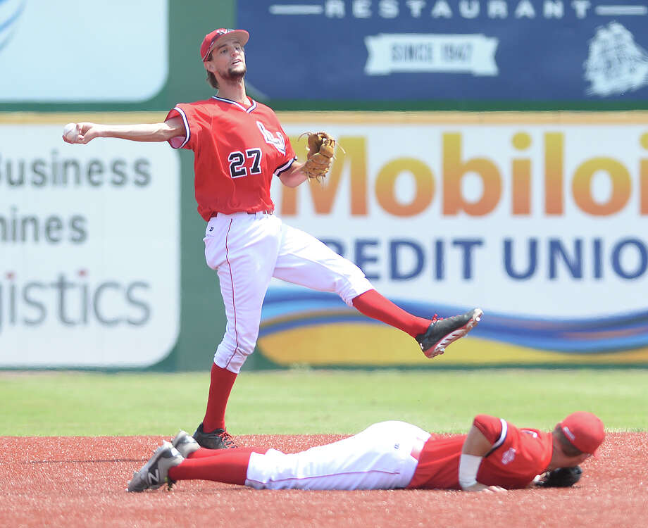 Lamar's Stijn Van Dermeer throws to first after backing up Reed Seeley during Saturday's home game against Texas A&M - Corpus Christi. Photo taken Saturday, April 4, 2015 Kim Brent/The Enterprise Photo: Kim Brent / Beaumont Enterprise