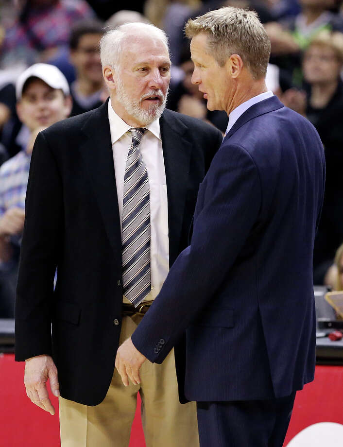 Spurs head coach Gregg Popovich (left) and Golden State Warriors head coach Steve Kerr talk after the game on April 5, 2015 at the AT&T Center. Photo: Edward A. Ornelas /San Antonio Express-News / © 2015 San Antonio Express-News