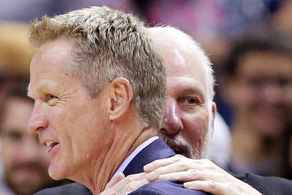 Golden State Warriors head coach Steve Kerr (left) and San Antonio Spurs head coach Gregg Popovich talk after the game on April 5, 2015, at the AT&T Center.