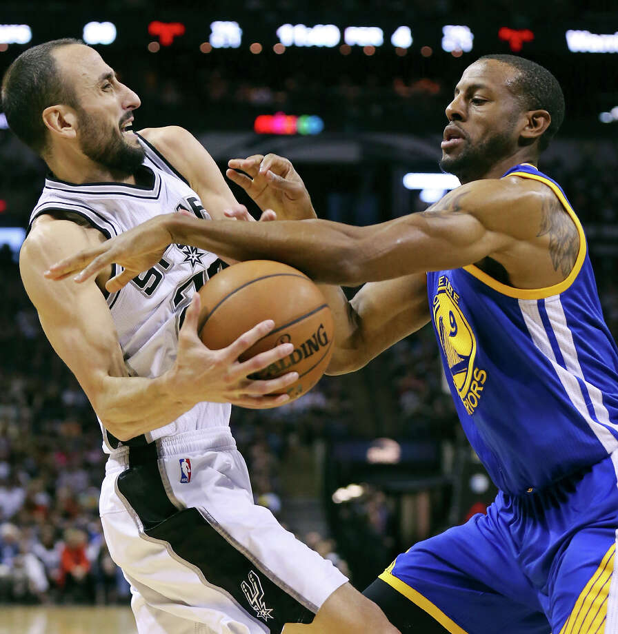 San Antonio Spurs' Manu Ginobili looks for room around Golden State Warriors' Andre Iguodala during second half action Sunday April 5, 2015 at the AT&T Center. The Spurs won 107-92. Photo: Edward A. Ornelas, Staff / San Antonio Express-News / © 2015 San Antonio Express-News
