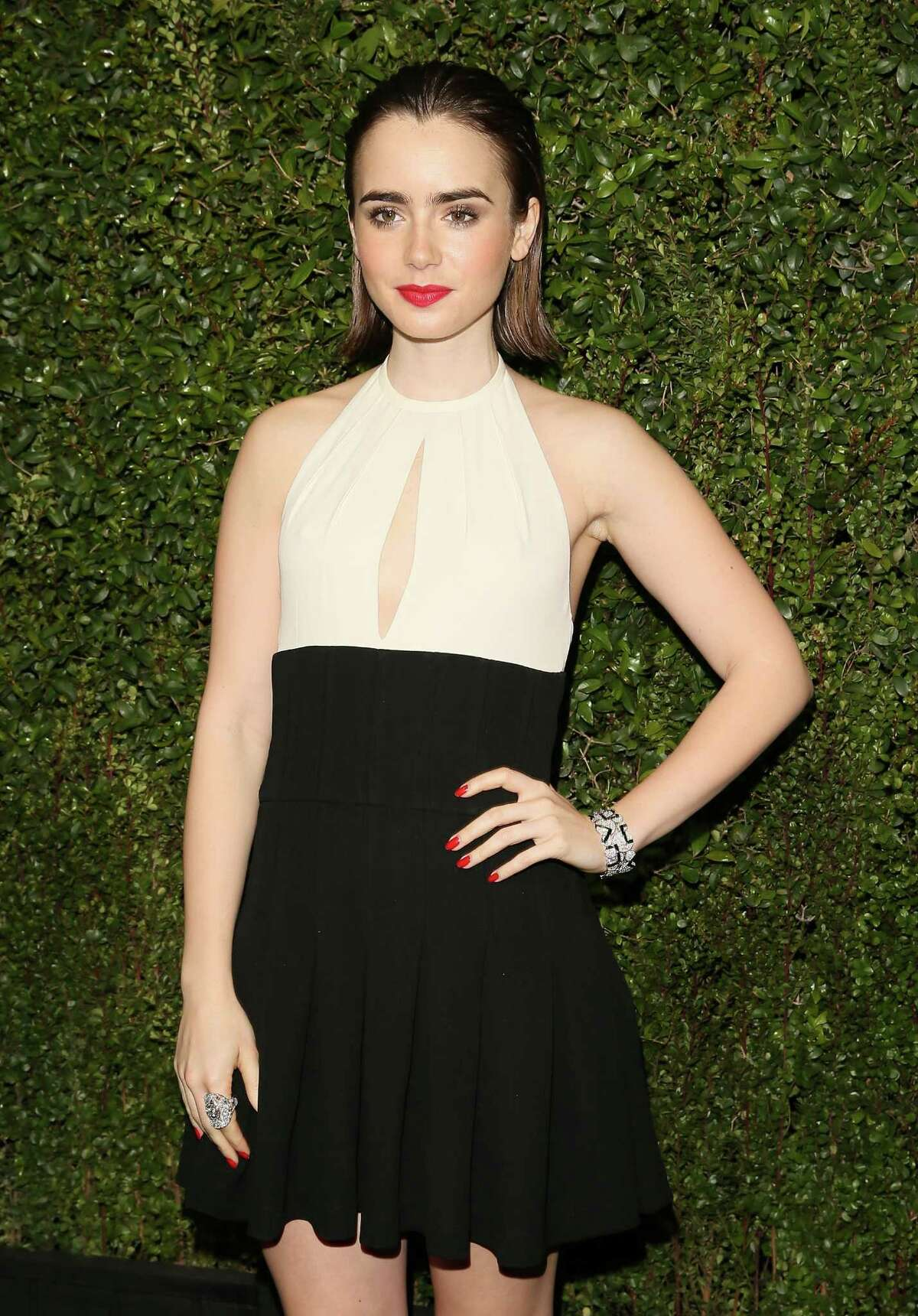 8. Lily Pictured: Lily Collins attends the Chanel And Charles Finch Pre-Oscar Dinner at Madeo Restaurant on February 21, 2015 in West Hollywood, California.
