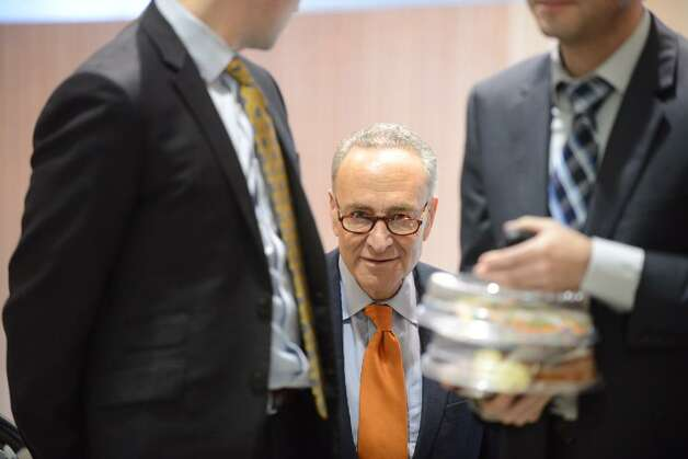 U.S. Senator Charles Schumer prepares for the announcement that JetBlue will begin flying out of Albany on Dec. 10. The discount airline will start its local service with direct flights to Fort Lauderdale, Fla., and Orlando, Fla. (Will Waldron / Times Union)
